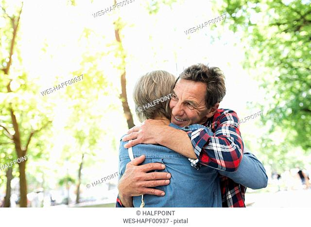 Senior couple embracing on the street