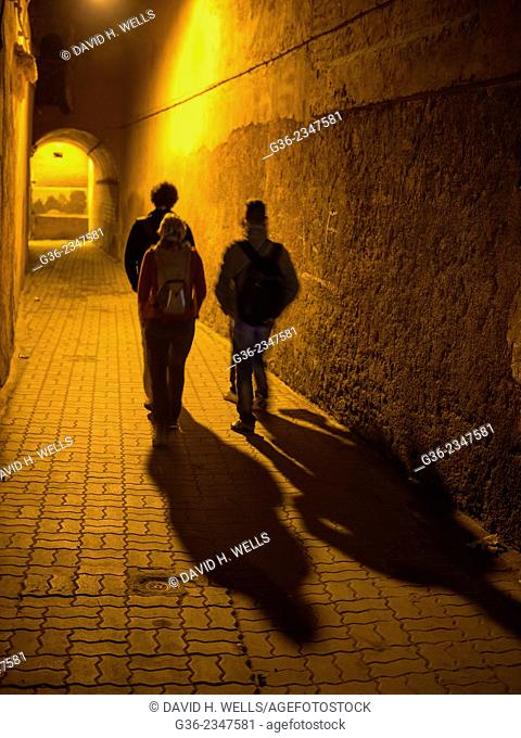 Silhouette of men walking on street in Marrakesch, Morocco