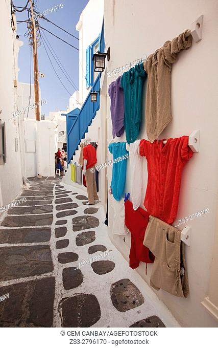 Colorful shirts for sale at the alleys of the town, Mykonos, Cyclades Islands, Greek Islands, Greece, Europe