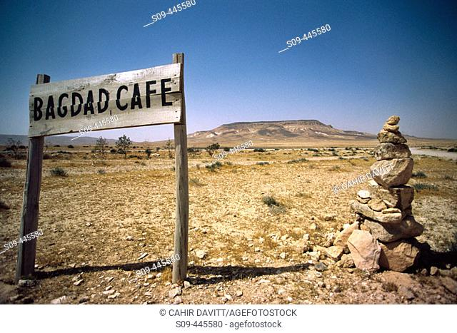 A sign marks the location of the Bagdad Café on the road junction to Iraq, Al'Ulayyaniyah in the Syrian desert. Syria