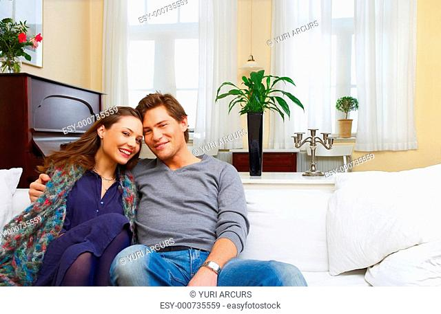Portrait of a young couple in their fashionable home Light through the windows