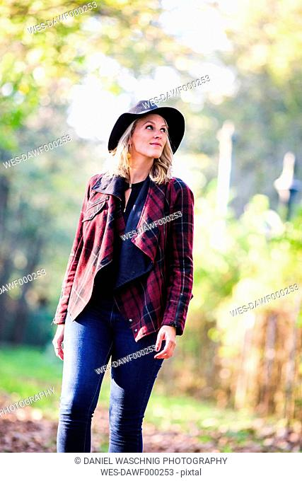 Woman wearing hat and checked jacket