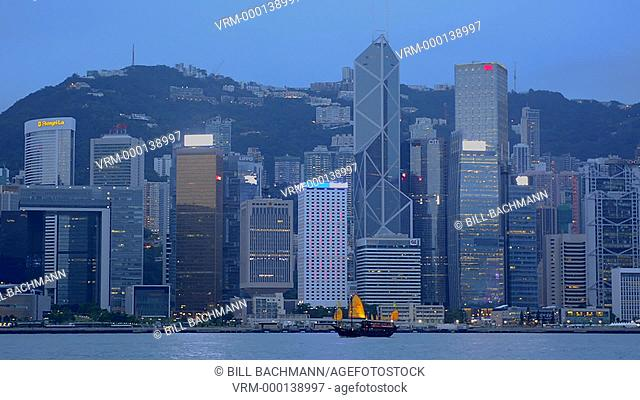 Hong Kong China skyline from water with boat against city background