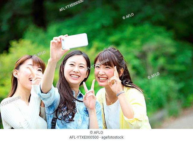 Young Japanese women taking a selfie together