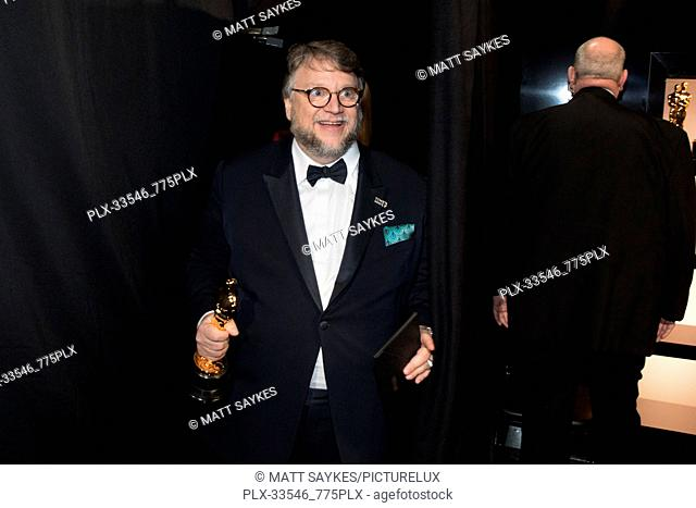 """Guillermo del Toro poses backstage with the Oscar® for achievement in directing for work on """"The Shape of Water"""" during the live ABC Telecast of The 90th..."""