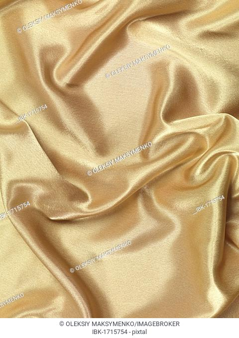 Golden shiny silky fabric, background