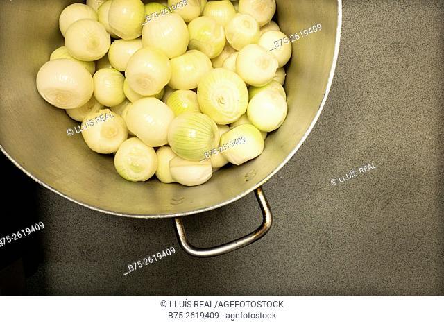 Peel onion in a pan. London, England, United Kingdom, Europe