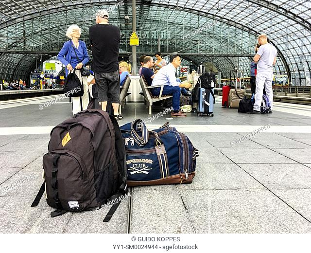 Berlin, Germany. Luggage left on a Railway Station's Platform, while other passengers wait for their connecting international train to Amsterdam