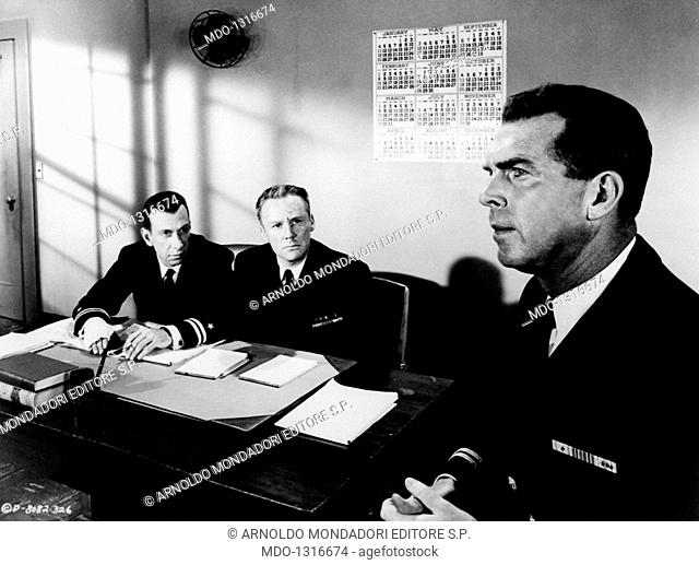Jose Ferrer, Van Johnson and Fred MacMurray in a scene from the film 'The Caine Mutiny'. Three military men in uniform in an office