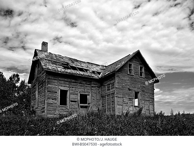wooden house falling into ruin