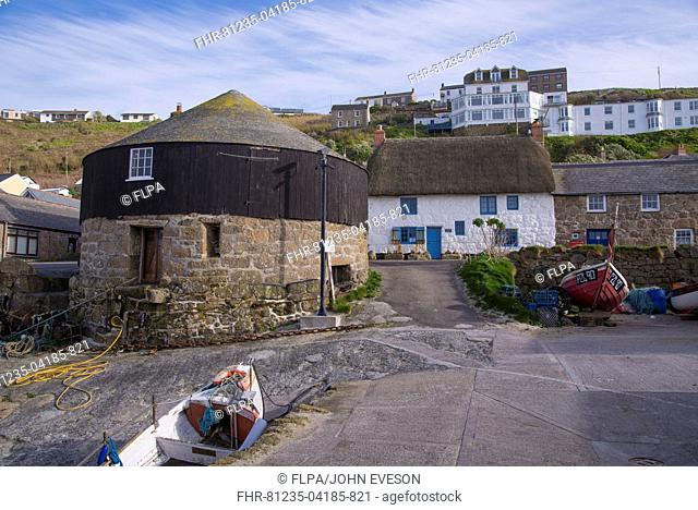 Coastal village with The Roundhouse (old capstan house), Sennen Cove, Sennen, Cornwall, England, May