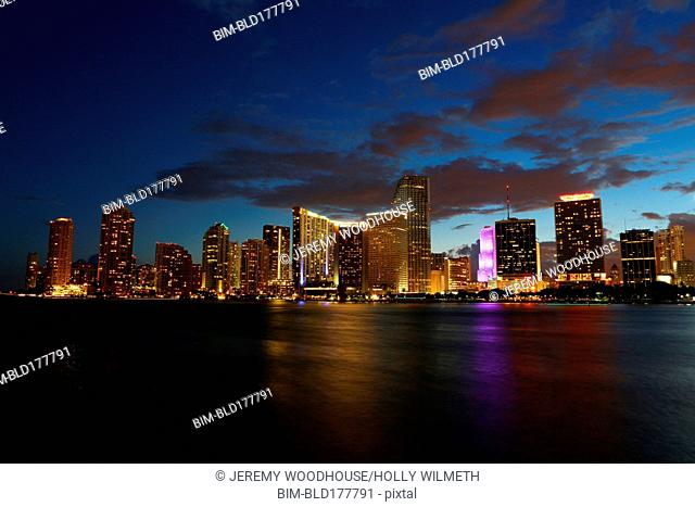 High rise buildings over Miami harbor at night, Florida, United States