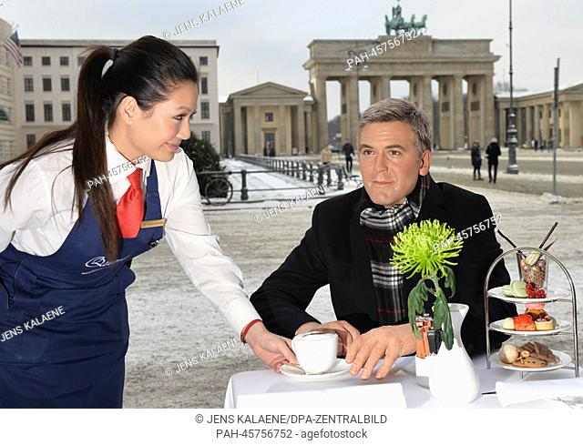 The wax figure of George Clooney from Madame Tussaud's sits in the cafe at Hotel Adlon near the Brandenburg Gate in Berlin,Germany, 23 January 2014