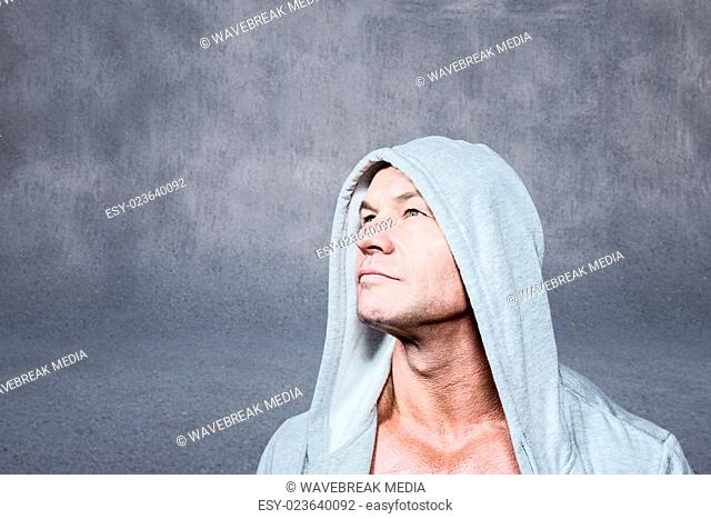 Composite image of thoughtful man looking up