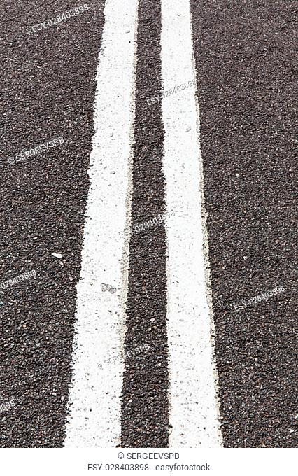 Asphalt road with white double solid line