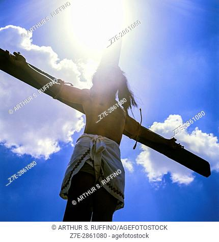 A penitent re-enacting the crucifixion of Jesus Christ during the Good Friday ritual in San Pedro Cutud, San Fernando City, Rampanga Province, Philippines