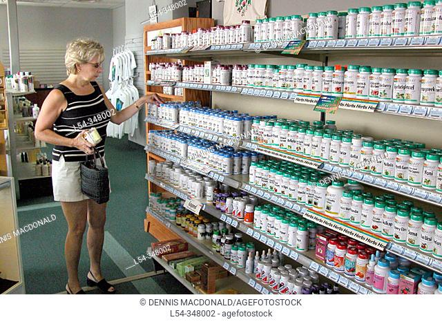 Woman shops for health product in a health food store