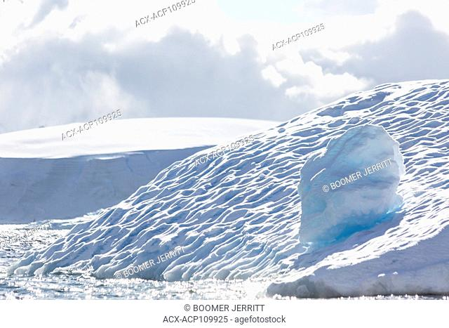 Icebergs as they melt form oft times, fantastic shapes and designs. Each one is different, Fournier Bay, Antarctic Peninsula