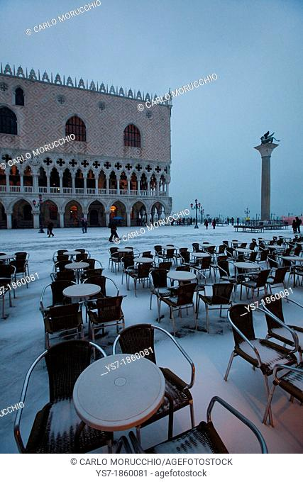 Doge's palace and Bar chairs covered with snow, St  Mark's square, Venice, Italy, Europe