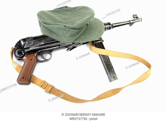 Germany in the Second World War. Standard army field cap kepi and submachine gun MP40