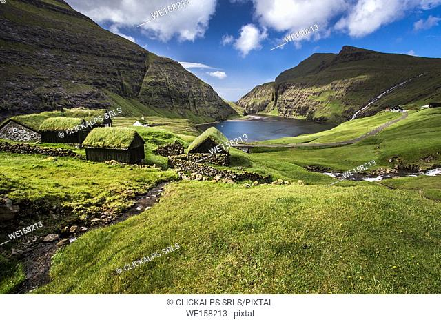 Nordic natural landscape, Saksun, Stremnoy island, Faroe Islands, Denmark. Iconic green roof houses