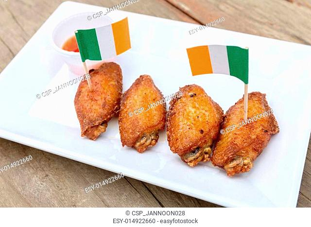 chicken wings on wooden table