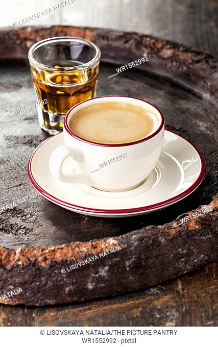 Coffee laced with brandy on dark background