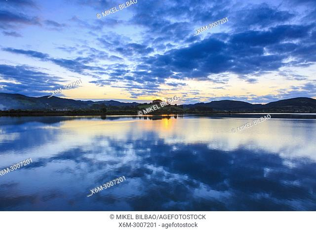 Salt marshes at dusk. Santoña, Victoria and Joyel Marshes Natural Park. Cantabria, Spain, Europe