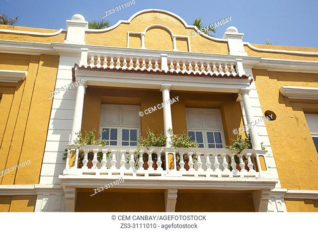View to the balcony on the facade of a colonial buildig at the historic center, Cartagena de Indias, Bolivar, Colombia, South America