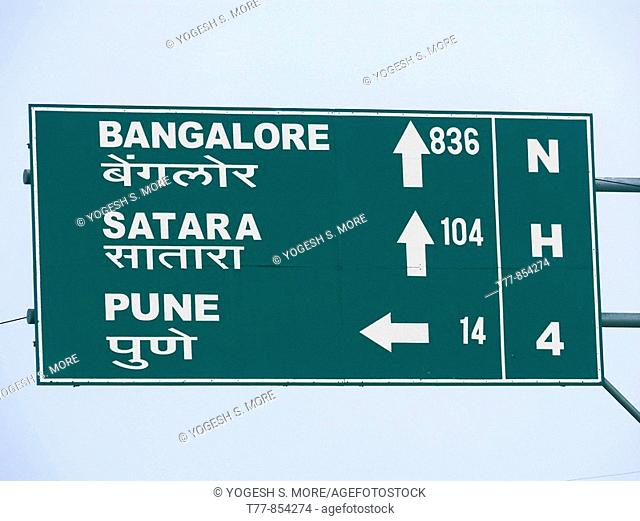 A signboard on a national highway four roadside is showing distances of Bangalore, Karad, Satara from Pune  Maharashtra, India