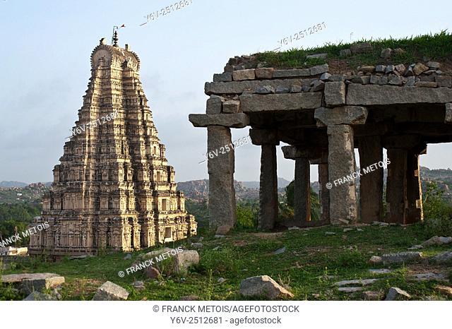 Ruins and ''gopuram'' of the Virupaksha temple at Hampi in Karnataka, India. A 'gopuram' is a monumental tower at the entrance of any hindu temple in south...