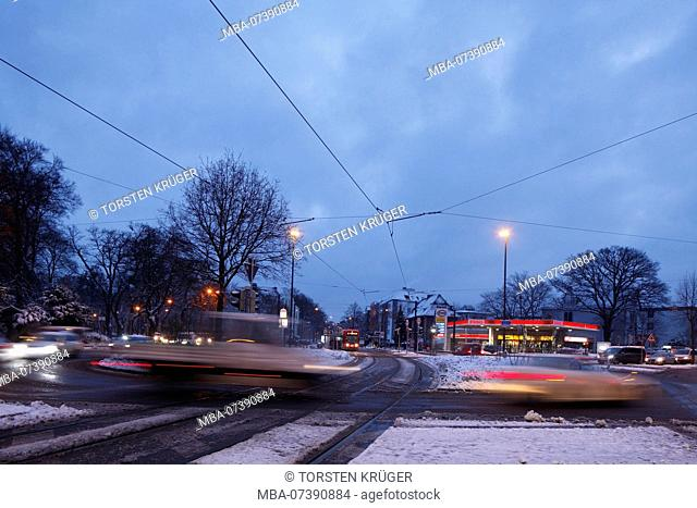 Snowy roundabout Am Stern with old houses at dusk in Schwachhausen, Bremen, Germany, Europe
