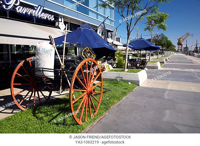 Argentina, Buenos Aires Province, Buenos Aires  Horse wagon with Mate sack, outside a cafe / restaurant on the dock side of Puerto Madero