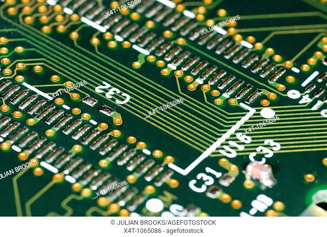 close up photograph of computer RAM memory chips, solder side
