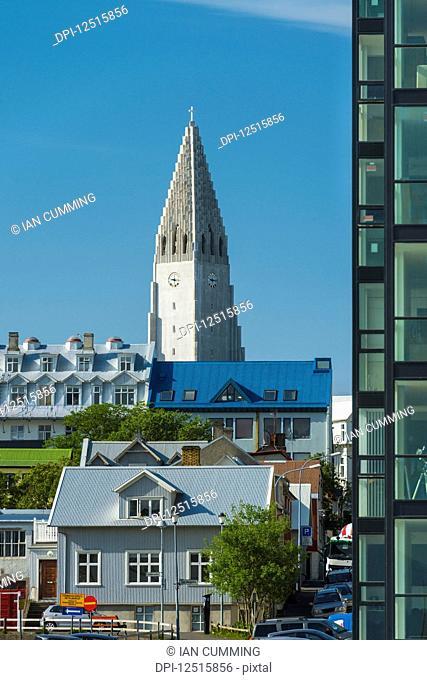 Looking past flats and houses to the Hallgrimskirkja (Hallgrimur church); Reykjavik, Iceland