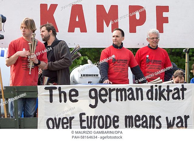 "Demonstrators from the 'class war not world war' (""""Klassenkampf statt Weltkrieg"""") group at the Soviet Memorial in Berlin, Germany, 8 May 2015"