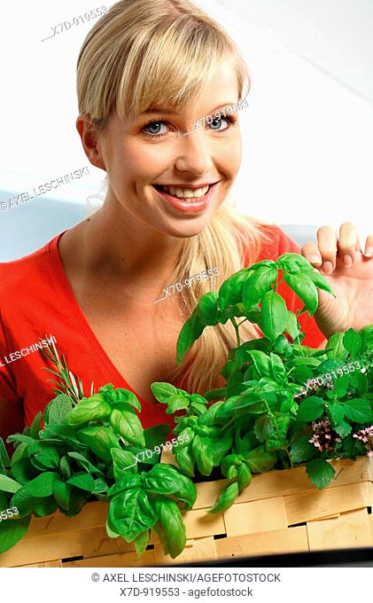 young woman preparing a meal with fresh vegetables