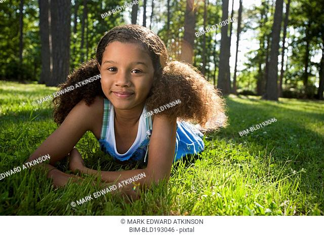 African American girl laying in grass
