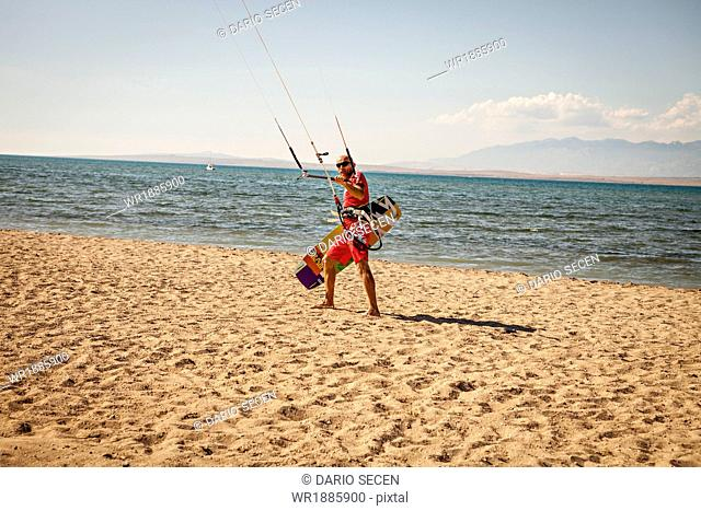 Croatia, Man with kite on beach