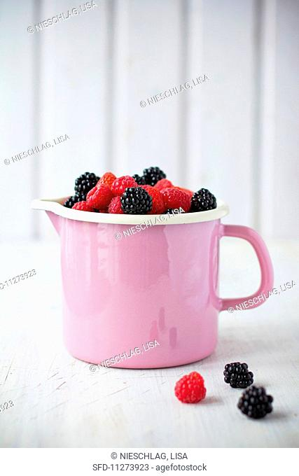 A cup of mixed berries