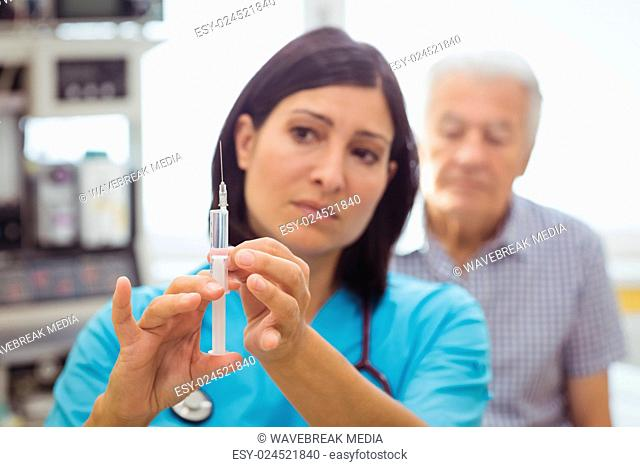 Female doctor holding an injection