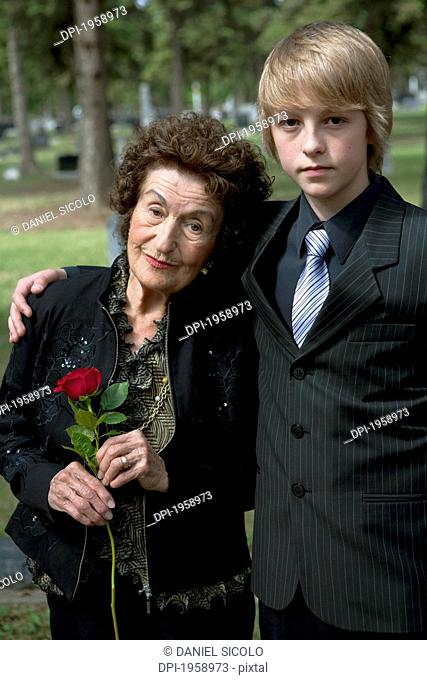 A Grandmother And Grandson In A Cemetery; Edmonton, Alberta, Canada