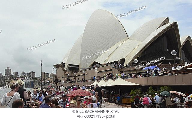Sydney Australia close up of famous Sydney Opera House with umbrellas and restaurants in New South Wales