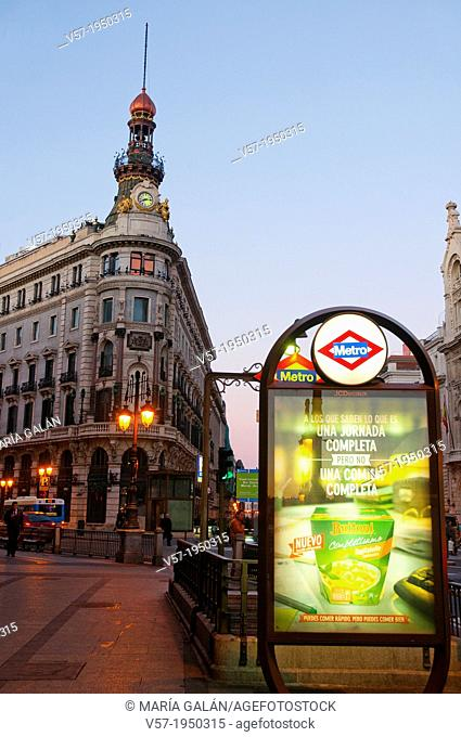 Sevilla street and Metro entrance at dawn. Madrid, Spain