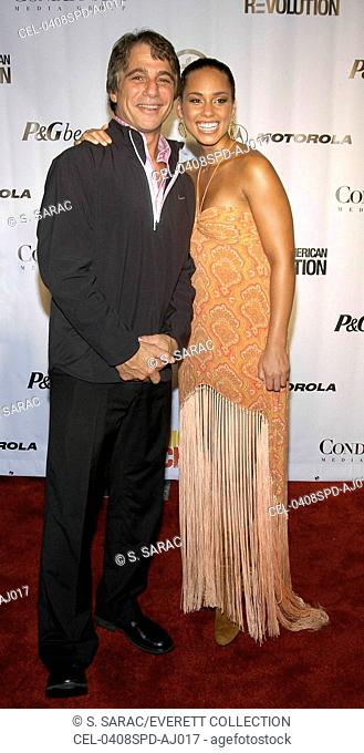 Actor Tony Danza and singer Alicia Keys arrive at Conde Nast's FASHION ROCKS: AN UNPRECEDENTED NIGHT OF STYLE AND SOUND, at Radio City Music Hall