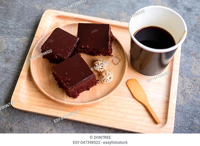 Cup of hot coffe with cake on wood tray