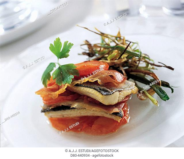 Lasagna of trout, ham and tomatoes