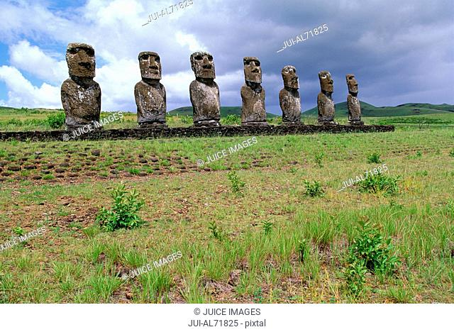 View of moai statues against cloudy sky, Chile, Easter Island (Rapa Nui)