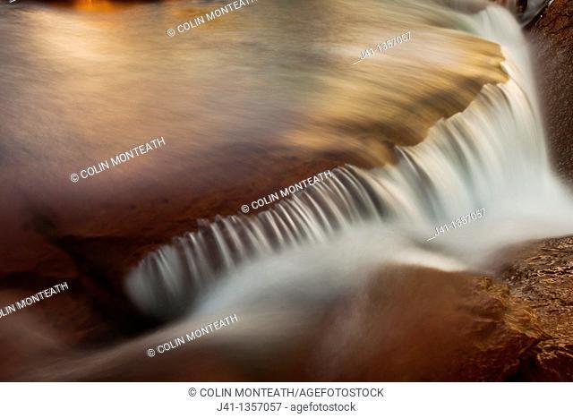 FitzRoy waterfall rapid catches first rays of dawn light under famous rock peak Cerro FitzRoy  El Chalten , Parque Nacional Los Glaciares, Patagonia, Argentina
