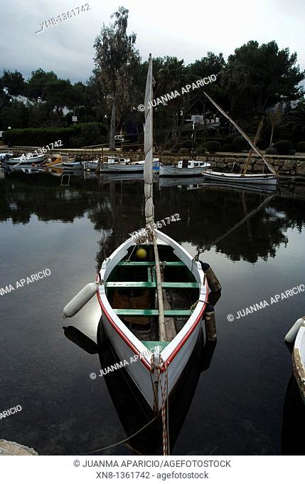 Ibiza boat docked at the mouth of the river at Santa Eulalia, Ibiza